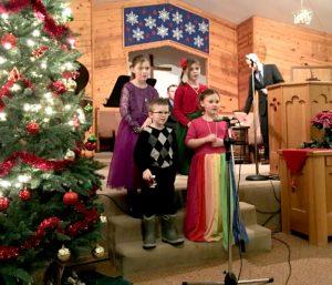 Kids singing carols